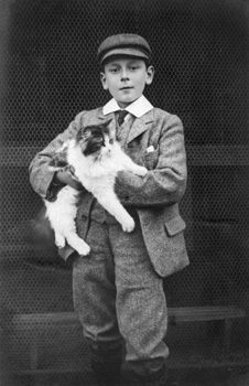 Maurice as a boy with cat